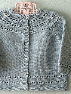Eyelet Yoke Baby Cardigan by Carole Barenys - this and other free baby knit patterns are for personal use or charity knitting.