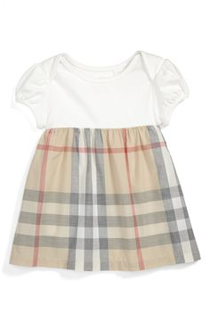 Such a cute little Burberry dress.
