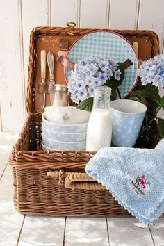 place vintage linens in basket hanging out then fill with wrapped silverware!