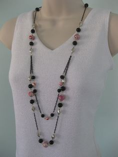Red White and Black Marble Beads, Black, and Silver Beaded Necklace on Multi Strands of Long Black Chains. Made by Ralston Originals on Etsy, $18.00.