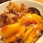 Sweet Georgia peaches are topped with homemade biscuits creating a bubbling Southern-style peach cobbler perfect for summer nights.