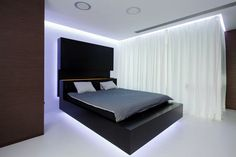 """""""The bedroom and the bathroom are a joined space separated by a clear glass wall and white curtain.""""    Read more at Design Milk: http://design-milk.com/apartment-interior-by-squareone/#ixzz1rzWNF7Ee"""