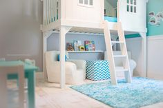 I am absolutely smitten with this beautiful turquoise blue and white boys room, complete with a tree house bed!