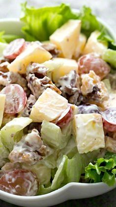 Waldorf salad Recipe ~ First presented at the Waldorf Astoria Hotel in 1893, the all-American Waldorf salad includes chopped apples, celery, grapes, and toasted walnuts in a mayonnaise dressing... feel free to substitute yogurt for the mayo
