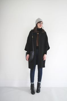 Winter 10 x 10 - Look 6 (Smart Casual)- Style Bee. Black turtleneck sweater+ochre wool linn tee+dark skinny jeans+black ankle heeled boots+black cocoon coat+grey beanie+black shoulder bag. Winter Mini Capsule Wardrobe 2017