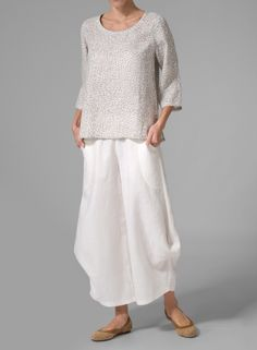 This top is comfortable yet trendy with its loose fit details! Pair with wide leg pants for a fashionable day outfit and to dress up for a night look.100% Natural Linen