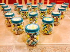 Made 40 of these candy jars and I am adding them to the tables along with the center piece. (4 per table)
