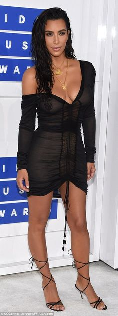 Kim Kardashian rocked sexy wet-look hair and a semi-sheer mini dress with ruche detail down the front