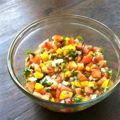 MANGO SALSA              2 cups diced Roma tomatoes      1 1/2 cups diced mango      1/2 cup diced onion      1 teaspoon white sugar      1/2 cup chopped fresh cilantro      2 tablespoons fresh lime juice      1 tablespoon cider vinegar      1/2 teaspoon salt      1/2 teaspoon black pepper      2 cloves garlic, minced    Directions        Stir the tomatoes, mango, onion, sugar, cilantro, lime juice, cider vinegar, salt, pepper, and garlic together in a bowl; refrigerate 1 hour before serving...