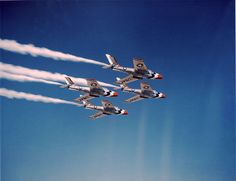 Four Republic F-84F Thunderstreak from the U.S. Air Force Thunderbirds aerobatics team flying in formation in 1955/56.