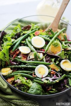 Green Bean and Egg Salad with Garlic Parmesan Vinaigrette - A simple salad of green beans, eggs and bacon tossed with an amazing Garlic Parmesan Vinaigrette. This is Spring in a salad bowl!  Get the recipe on diethood.com