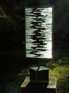 Splintered Vision glass sculpture by Jane Bohane, shown on Art Parks International website. Medium: brushed steel and glass shards.