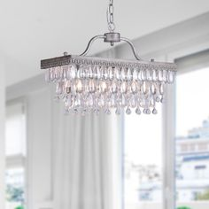 Add an elegant touch to your home with this opulent three-light chandelier. This beautiful pendant fixture features three delicate rows of crystal glass and a sophisticated antique silver finish giving it a dramatic look that is sure to draw attention.