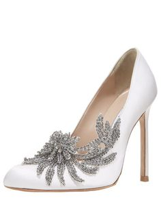 """Shoes are never too good to be true. The Manolo Blahnik Swan pump steps out of the silver screen—we couldn't think of a better """"something new"""" for your big day. Satin pump features crystal-beaded vine applique angled across vamp and outer side."""