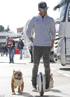 Lewis, hopped on his trusty one-wheeled hoverboard as he enjoyed a low-key outing with his beloved pooches - Roscoe and Coco - during day one of winter testing on Tuesday. F1 Lewis Hamilton, Lewis Hamilton Formula 1, Still I Rise, English Bulldogs, George Michael, Future Tech, Car And Driver, One Team, Formula One