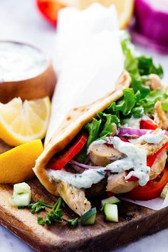 Easy to make chicken gyros that only take minutes to throw into the slow cooker!  They are light and delicious ...