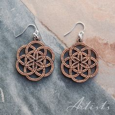 the_artists_design_studioSeed of Life earrings. The Artists is an online design company, specializing in jewellery and 3D design, as well as the curation of beautiful design pieces and art. Visit our Facebook page www.facebook.com/theartists.co.za #theartistsdesign #theartistsstudio #theartistsjewellery #jewelry #designer #art #design #imagineersdesignerscreators #jewellery #natural #wood #geometry #spiritual