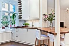 white kitchen cabinets and wooden table