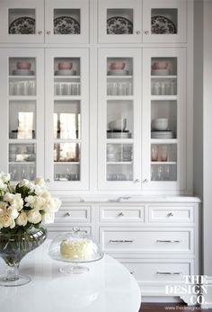 custom kitchen, white kitchen, parisian chic, built-in buffet, glass display, white roses,