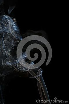 Abstract art. Color blue smoke from the aromatic sticks on a black background. Background for Halloween. Texture fog. Design element. The concept of aromatherapy.