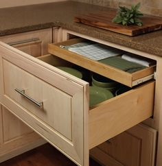Merillat Masterpiece® Base Deep Drawer Combination Keep linens conveniently tucked away in this hidden roll out tray nestled in two deep drawers. Deep Drawer Organization, Drawer Dividers, Drawer Organisers, Storage Drawers, Storage Cabinets, Storage Spaces, Kitchen Drawer Inserts, Kitchen Drawers, Kitchen Storage