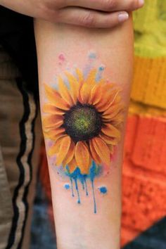 Sunflower tattoos for women aren't just for aesthetic value and artistic expression, they can also have specific interpretations and personal significance behind them. Explore the meanings behind sunflower tattoos here and see beautiful examples. Watercolor Sunflower Tattoo, Sunflower Tattoo Meaning, Sunflower Tattoo Simple, Sunflower Tattoo Sleeve, Sunflower Tattoo Shoulder, Sunflower Tattoos, Sunflower Tattoo Design, Tattoo Watercolor, Sunflower Mandala Tattoo