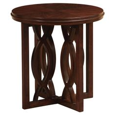 Round lamp table with waving latticework and a hand-applied walnut finish. Made in Indonesia.  Product: Lamp tableCo...