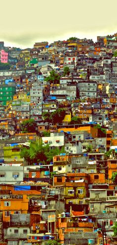 Favela (Slum)  in Brazil - A favela is a slum, an illegal settlement built on squatted lands. Brazil has one of the worst distributions of wealth in the world and the poor have got to live somewhere. The favela dwellers build their houses out of wood and garbage, then later when they have the money, they upgrade to a home made concrete home.