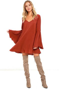 We get a special feeling every time we set eyes on the Something Magical Rust Red Long Sleeve Shift Dress! A wide V-neckline tops a woven shift bodice, framed by long bell sleeves. Low V-back (with strap accent).