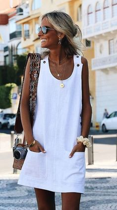 30 Perfect Vacation Outfits for Every Destination : summer outfit inspiration / white dress and bag
