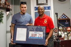 Secretary of State Jesse White honors Chicago Cubs player Javier Baez with the Sportsman of the Year Award Friday. | Santiago Covarrubias/Sun-Times