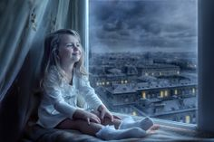 Sofia - I adore this photo... the expression on her face... the window ... night... clouds