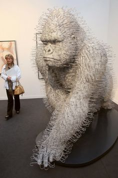 David Mach  Hundreds of used coathangers go into the sculpture work of David Mach, who uses other recycled materials to do larger-than-life sculptures. This gorilla is one of his most impressive examples.