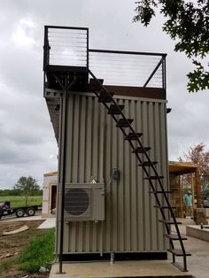 This is a custom staircase that leads you to the rooftop of this shipping container tiny house by Custom Container Living LLC out of Archie, Missouri. Pretty cool, right?