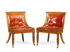 PAIR OF LIBRARY CHAIRS, G,eorge IV, circa 1825, pollarded oak  with buttoned red leather upholstery, the feet ending in brass cappings and castors
