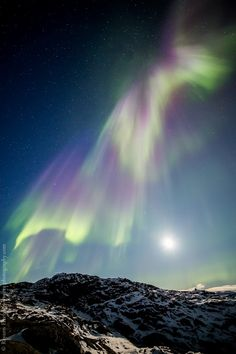 We are currently under the influence of a coronal hole solar wind stream and that means enhanced auroral displays! Check out this amazing image captured by Rayann Elzein last night in Greenland. Stunning!