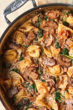 Creamy Spinach Mushroom Tortellini with Caramelized Onions is an Italian pasta dish packed with veggies. This easy and delicious meatless recipe is a perfect weeknight dinner! If you're looking for a simple creamy tortellini recipe, Farfalle Recipes, Tortellini Recipes, Pasta Recipes, Cooking Recipes, Tortellini Pasta, Italian Pasta Dishes, Creamy Pasta Dishes, Mushroom Dish, Spinach Stuffed Mushrooms