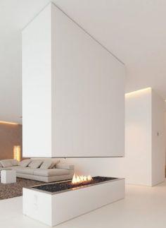 Wit gestucte open haard met doorkijk #haard #wit #design