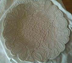Elegant and oh, so beautiful!  This hand made plate was impressed with a lace doily. She uses a lot of different stamps on her work - great texture and interest. The artist is Rowena and her site it Row's Pottery Shed.  She's from Sydney Australia, and has some inspirational projects you should check out!