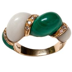 A sensuous shrimp ring of malachite, white coral and brilliant cut diamonds set in 18 karat yellow gold $1200