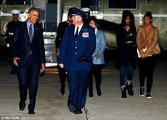 Obama, pictured here walking with US Air Force Colonel John Millard Andrews, will visit San Bernardino before his annual December vacation