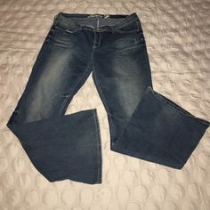 Seven 7 jeans bootcut distressed designer pants Worn twice. Size 16. Seven 7 jeans bootcut comfortable stretch fit button with zipper closure. Signature 7 on rear pockets Seven7 Jeans Boot Cut