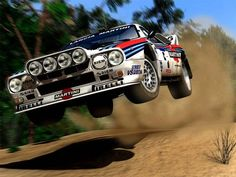 The beautiful Lancia 037 Group B rally car, driven by Markku Alén, Attilio Bettega, and Walter Röhrl, won Lancia the manufacturers' world championship in the 1983 season. It was the last rear-wheel drive car to win the WRC. Martini Racing, Pajero Off Road, Rallye Automobile, Audi, Porsche, Rally Raid, Lancia Delta, Car Shop, Vintage Racing
