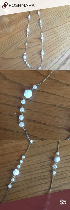 Long necklace with white rose detail❣️ Forever 21 necklace. Gold chain with white roses and pearl beading! Worn maybe a few times great condition!!                                                                        15% off purchase of 2 items or more!!💕.                                                  Make an offer.                                                                         No trades. I really want to get rid of some stuff 💕 Forever 21 Jewelry Necklaces