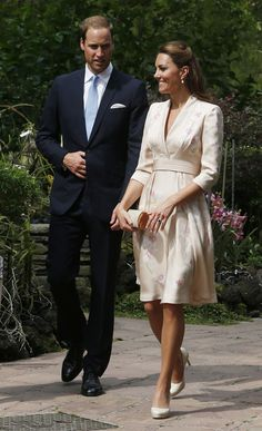Kate's orchid-print Jenny Packham dress matched the scenery of the Singapore Botanical Gardens in September...