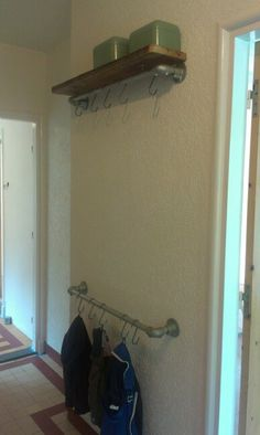 Simple entry way rack made with Kee Klamp pipe fittings.