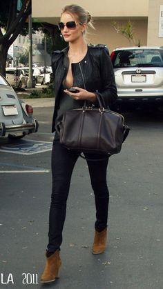 Black skinny pants, black jacket and light boots