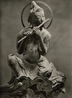 """A Musical Bodhisatva  A close-up of one of these images--this one playing a flute.  photo by a Japanese photographer, from a 1966 portfolio of photos of """"The Byodo-in"""""""