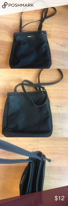 Nine West black shoulder bag Nine west black shoulder bag. It has three big zippered areas and the middle zipper area has a smaller zipper inside along with an organizer for credit cards and pens. Nine West Bags Shoulder Bags