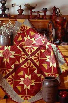 Rust and Yellow Quilt and Stoneware